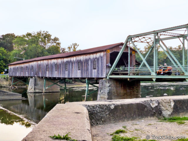 Harpersfield Covered Bridge viewed from the side with windows.