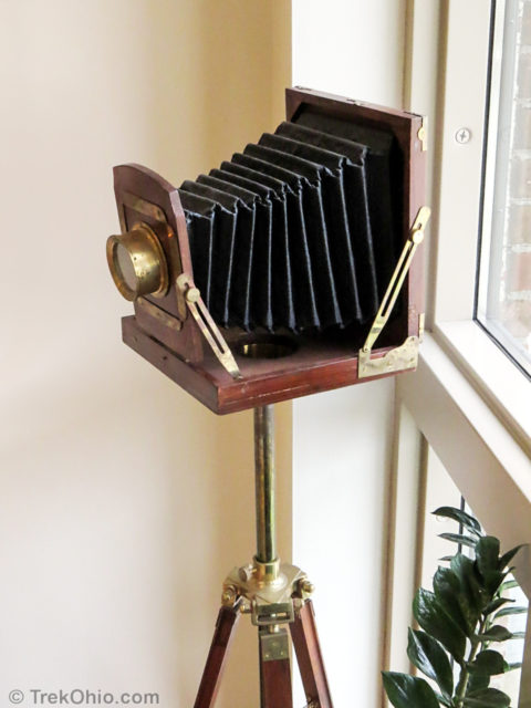 A wooden view camera on display